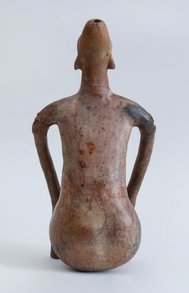 Pottery Figure of a Seated Female